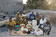 (MODEL RELEASED IMAGE). The Natomo family on the roof of their mud-brick home in Kouakourou, Mali, with a week's worth of food. The Natomo family is one of the thirty families featured in the book Hungry Planet: What the World Eats (p. 206).