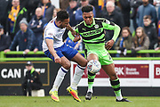 Mansfield Town's Rhys Bennett(2) and Forest Green Rovers Tahvon Campbell(25) during the EFL Sky Bet League 2 match between Forest Green Rovers and Mansfield Town at the New Lawn, Forest Green, United Kingdom on 24 March 2018. Picture by Shane Healey.