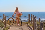 Young Girl Model with Long Blonde Hair with a Beach Cruiser Bike