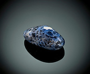 Cutout of a sodalite gemstone on black background