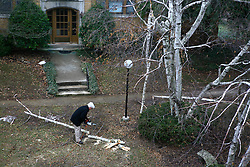 Greenhill neighbor removes trees after an Ice Storm, Sunday, Feb. 08, 2009 at Greenhill Condominiums in Louisville.
