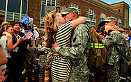 Alicia Conley welcomes her husband Randy back at the 109th field artillery on Thursday at noon.