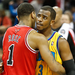 February 12, 2011; New Orleans, LA, USA; New Orleans Hornets point guard Chris Paul (3) and Chicago Bulls point guard Derrick Rose (1) hug following  a game at the New Orleans Arena.  The Bulls defeated the Hornets 97-88. Mandatory Credit: Derick E. Hingle