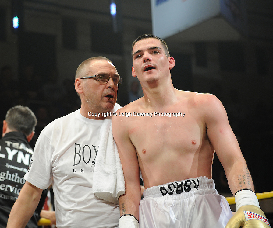 Bobby Gladman with trainer Johnny Eames following his defeat against Colin Lynes in Quarter Final Three at Prizefighter Welterweights II,York Hall, Bethnal Green ,London. Matchroom Sport/Prizefighter.Photo credit: Leigh Dawney 2011 07.06.11