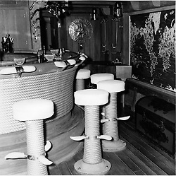 Interior shots of Aristotle Onassis's yacht Christina photographed in 1956.<br /> Picture shows The Bar.  Whales teetch provide the footrests to the stools in the bar.  The seats are covered in whale skin and the hand-grips around the bar are also made of whales teeth are engraved with scenes from the Odessey of Ulysses<br /> <br /> <br /> NON EXCLUSIVE - WORLD RIGHTS