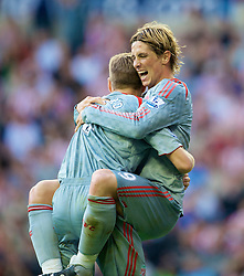 SUNDERLAND, ENGLAND - Saturday, August 16, 2008: Liverpool's Fernando Torres celebrates scoring the match-winning goal against Sunderland with team-mate captain Steven Gerrard MBE during the opening Premiership match of the season at the Stadium of Light. (Photo by David Rawcliffe/Propaganda)