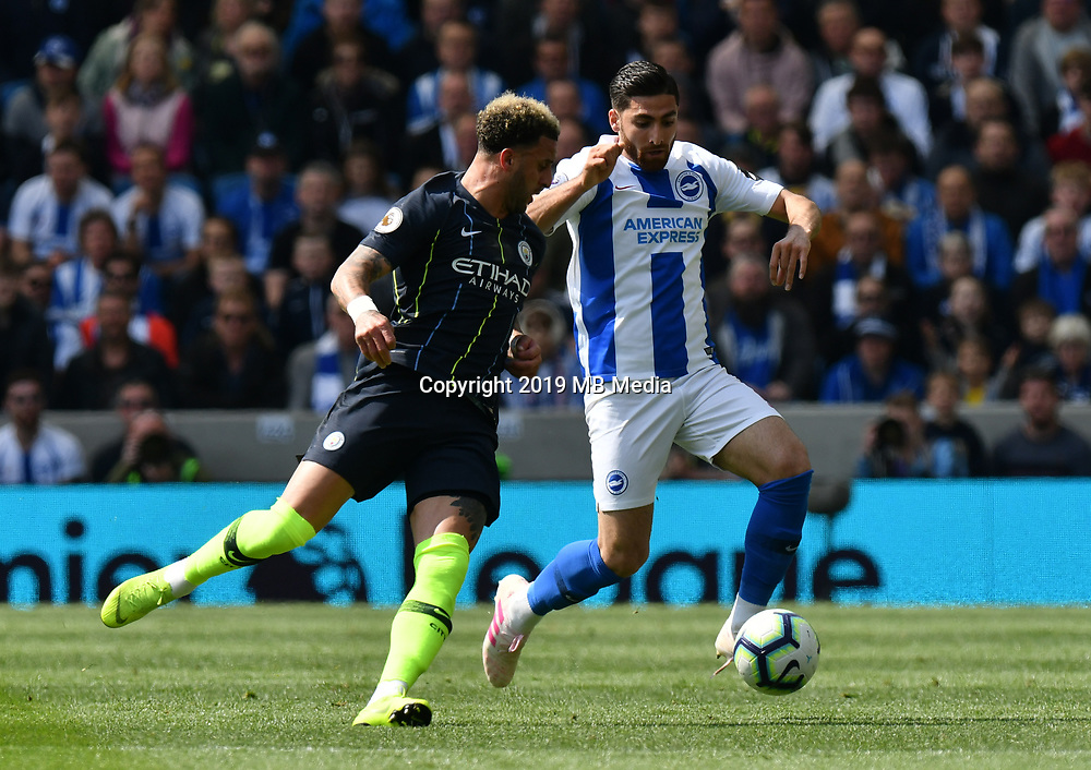 BRIGHTON, ENGLAND - MAY 12:  Kyle Walker (2) of Manchester City battles for possession with Alireza Jahanbakhsh (16) of Brighton and Hove Albion during the Premier League match between Brighton & Hove Albion and Manchester City at American Express Community Stadium on May 12, 2019 in Brighton, United Kingdom. (MB Media)