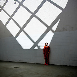A female inmate pauses to let a patch of sunlight hit her face while spending time in the outdoor recreation area of Pod 3 women's detention area of the Canyon County Jail in Caldwell, Idaho. Thursday May 26, 2016