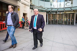 © Licensed to London News Pictures. 23/04/2017. London, UK. Chairman of the Conservative Party Patrick McLoughlin (R) leaves Broadcasting House after appearing on Sunday Politics. McLoughlin is reported to have said that Jeremy Corbyn, Leader of the Labour Party, 'is not suitable to become prime minister of this country' in the upcoming 8 June General Election. Photo credit: Rob Pinney/LNP