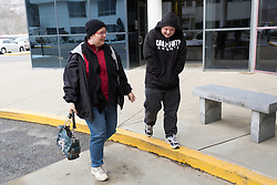 1/27/15 10:21:24 AM -- Louisa, KY, U.S.A  -- Cheryl Castle, left, walks with her son Nate into Children's Care of Eastern Kentucky for an appointment Tuesday. Nate had a low grade fever and a cough and was being checked by Dr. Mazen Jaafar the pediatrician who has been all  three of Cheryl's since birth. Cheryl is a recent recipient of the high-tech device, can now do many tasks she was unable to do when her epileptic seizures became more severe and more frequent. Now she's getting back to a normal life.<br /> <br />  --    Photo by Jonathan Palmer, Freelance