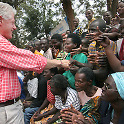July, 15, 2006 - President Bill Clinton greets well wishers outside the district hospital in Rwinkwavu, Rwanda, which the Clinton Foundation renovated in partnership with Dr. Paul Farmer's Partners in Health. Photo by Evelyn Hockstein