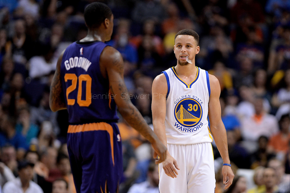 Feb 10, 2016; Phoenix, AZ, USA; Golden State Warriors guard Stephen Curry (30) walks in front of Phoenix Suns guard Archie Goodwin (20) at Talking Stick Resort Arena. The Golden State Warriors won 112-104. Mandatory Credit: Jennifer Stewart-USA TODAY Sports