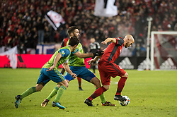 December 9, 2017 - Toronto, Ontario, Canada - Toronto FC midfielder MICHAEL BRADLEY (4) dribbles the ball away from \Seattle Sounders defender WILL BRUIN (17) during the MLS Cup championship match at BMO Field in Toronto, Canada.  Toronto FC defeats Seattle Sounders 2 to 0. (Credit Image: © Mark Smith via ZUMA Wire)