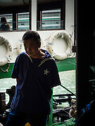 """10 AUGUST 2013 - HONG KONG:  A worker for the Star Ferry Company as a ferry sits at its mooring on the Kowloon side of Victoria Harbor. The Star Ferry, or The """"Star"""" Ferry Company, is a passenger ferry service operator and tourist attraction in Hong Kong. Its principal routes carry passengers across Victoria Harbour, between Hong Kong Island and Kowloon. It was founded in 1888 as the Kowloon Ferry Company, adopting its present name in 1898.<br /> The fleet of twelve ferries currently operates two routes (four prior to April 1, 2011) across the harbour, carrying over 70,000 passengers a day, or 26 million a year. Even though the harbour is crossed by railway and road tunnels, the Star Ferry continues to provide an inexpensive mode of harbour crossing. The company's main route runs between Central and Tsim Sha Tsui. Hong Kong is one of the two Special Administrative Regions of the People's Republic of China, Macau is the other. It is situated on China's south coast and, enclosed by the Pearl River Delta and South China Sea, it is known for its skyline and deep natural harbour. Hong Kong is one of the most densely populated areas in the world, the  population is 93.6% ethnic Chinese and 6.4% from other groups. The Han Chinese majority originate mainly from the cities of Guangzhou and Taishan in the neighbouring Guangdong province.      PHOTO BY JACK KURTZ"""