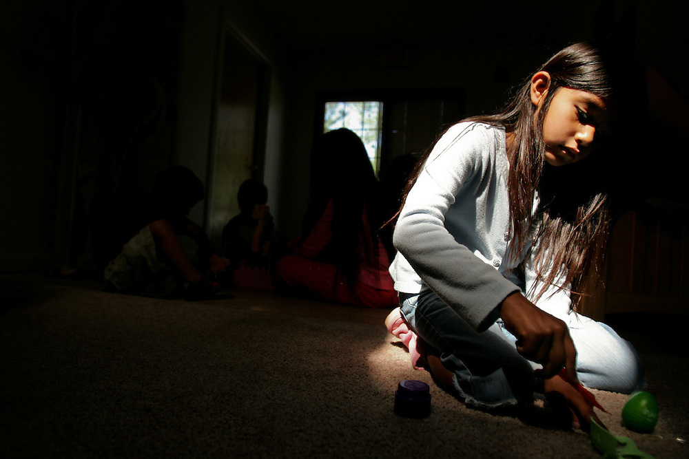 Xavier Mascareñas/The Daily Times; Trista, 6, a child staying at the Christian organization Navajo Ministries in Farmington, N.M., plays under a skylight July 10, 2009, in a shared room in Jonathan and Christine Wood's house on the 17-acre site. The Wood's asked that the children only be referred to by first name to avoid identification.