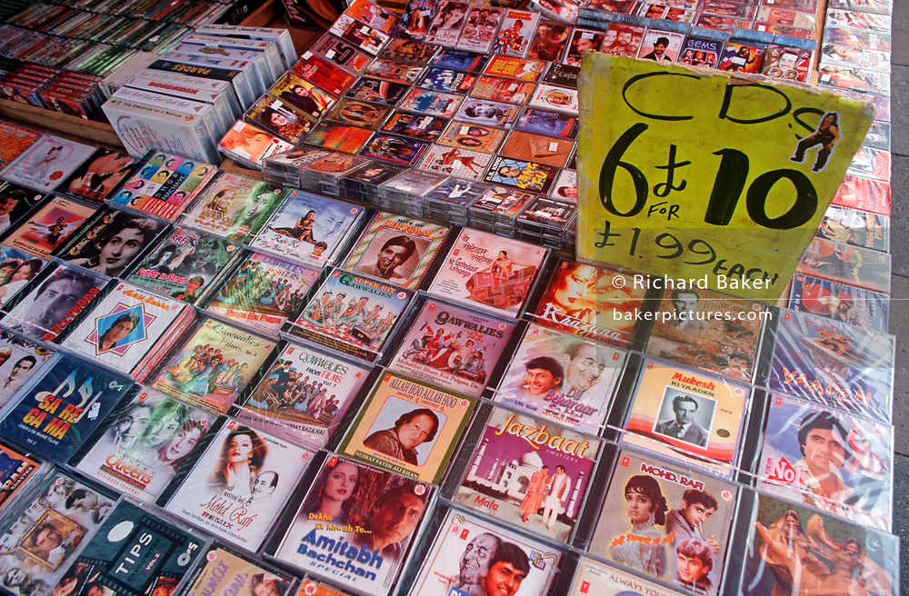 Multibuy CDs for Indian popular music and Bollywood soundtracks are on sale in Southall, a West London neighbourhood for the British Asian community, on 16th August 1998, in London, England. (Photo by Richard Baker / In Pictures via Getty Images)