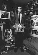 Rock'n'roll fan in his bedroom holding a Eddie Cochran record, UK, 1980s.