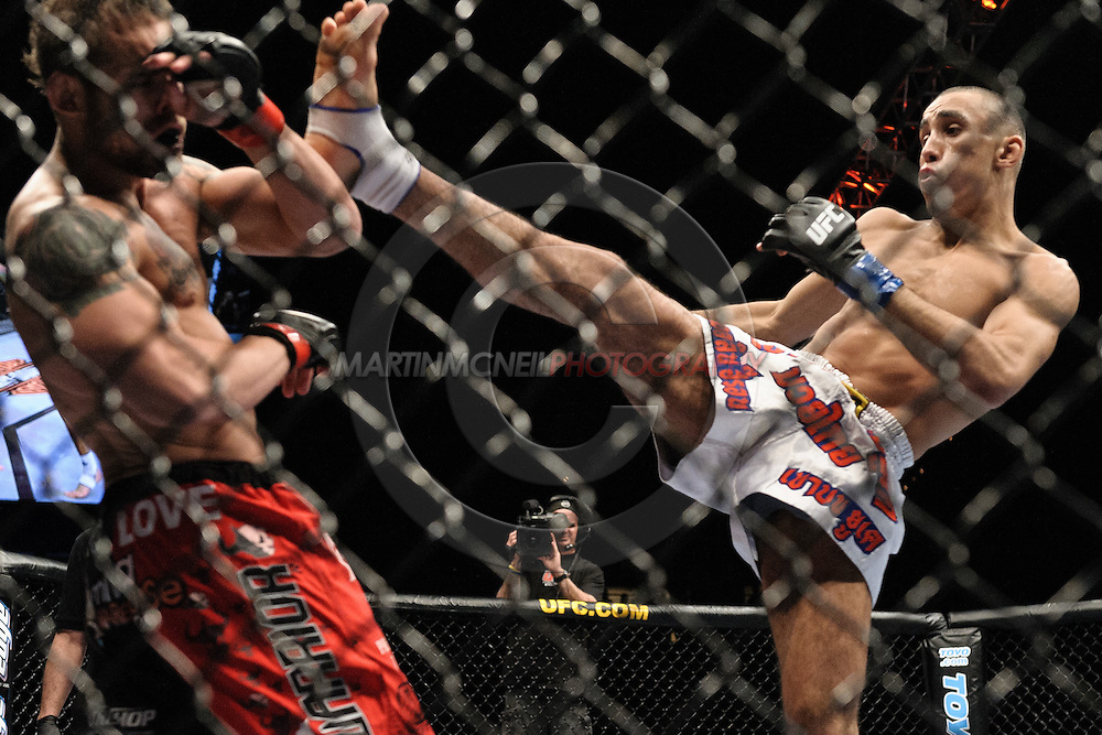 "LAS VEGAS, NEVADA, MAY 24, 2008: Rich Clementi (left) is rocked by a kick from Terry Etim during ""UFC 84: Ill Will"" inside the MGM Grand Garden Arena in Las Vegas"