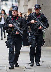 © Licensed to London News Pictures. 24/03/2016. London, UK. Armed police officers outside The Old Bailey in London where Radical preacher Anjem Choudary is due to appear. Choudary is alleged to have invited support for the Islamic State group in individual lectures which were subsequently posted online. Photo credit: Peter Macdiarmid/LNP