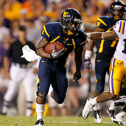 Sep 25, 2010; Baton Rouge, LA, USA; West Virginia Mountaineers wide receiver Jock Sanders (9) runs against the LSU Tigers during the second half at Tiger Stadium. LSU defeated West Virginia 20-14.  Mandatory Credit: Derick E. Hingle