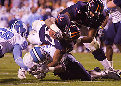 "Virginia running back Cedric Peerman (37) dives for the game winning touchdown in overtime.  The Virginia Cavaliers defeated the #18 ranked North Carolina Tar Heels 16-13 in overtime in NCAA football at Scott Stadium on the Grounds of the University of Virginia in Charlottesville, VA on October 18, 2008.  The 113th meeting of the two teams, dubbed the ""Oldest Rivalry in the South"", saw UVA continue its streak of consecutive home victories over UNC -- the last time the Tar Heels won in Charlottesville was 1981."