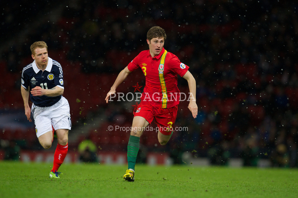 GLASGOW, SCOTLAND - Friday, March 22, 2013: Wales' Ben Davies in action against Scotland during the 2014 FIFA World Cup Brazil Qualifying Group A match at Hampden Park. (Pic by David Rawcliffe/Propaganda)