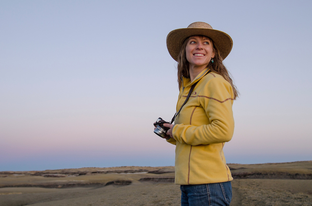 Writer Rachel Shockley, explores the Bisti Badlands wilderness area in Northern New Mexico, camera in hand.
