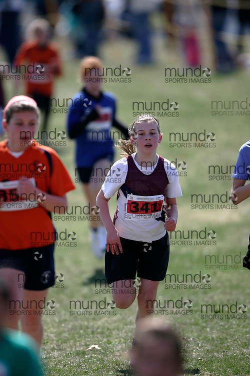 (Kingston, Canada---11 April 2010) Holly  Hebert (#341) of Lancaster Drive PS runs in the Elementary Girls race at the 17th World University Cross Country Championships (FISU) held on the Fort Henry Hill course in Kingston, Ontario, Canada. .Geoff Robins/ Mundo Sport Images..This photograph is Copyright Geoff Robins / Mundo Sport Images, 2010. For information, go to www.mundosportimages.com or contact info@mundosportimages.com.