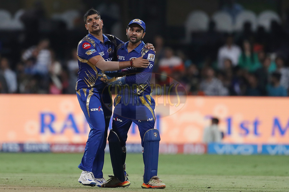 Karn Sharma of the Mumbai Indians celebrates the wicket of Ishank Jaggi of the Kolkata Knight Riders with Parthiv Patel of the Mumbai Indians during the 2nd qualifier match of the Vivo 2017 Indian Premier League between the Mumbai Indians and the Kolkata Knight Riders held at the M.Chinnaswamy Stadium in Bangalore, India on the 19th May 2017<br /> <br /> Photo by Ron Gaunt - Sportzpics - IPL