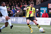 Harrogate Town midfielder Joe Leesley (11) crosses the ball during the Vanarama National League match between FC Halifax Town and Dover Athletic at the Shay, Halifax, United Kingdom on 17 November 2018.