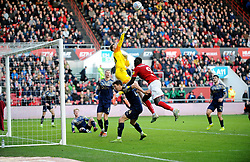 Bradley Collins of Barnsley saves a shot from Famara Diedhiou of Bristol City-Mandatory by-line: Nizaam Jones/JMP - 18/01/2020 - FOOTBALL - Ashton Gate - Bristol, England - Bristol City v Barnsley - Sky Bet Championship