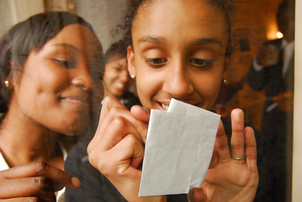 Citizen School students exchange a quick note at the Bridging Magazine Launch held at the Boston Public Library.