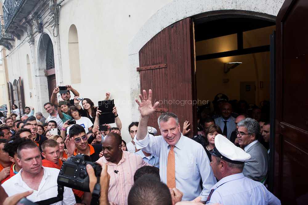 GRASSANO, ITALY - 24 JULY 2014:  Mayor of New York Bill de Blasio waves to the crowd as he leaves Grassano, his ancestral home town in Italy, on July 24th 2014.<br /> <br /> New York City Mayor Bill de Blasio arrived in Italy with his family Sunday morning for an 8-day summer vacation that includes meetings with government officials and sightseeing in his ancestral homeland.