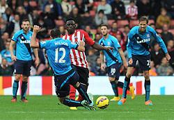 Southampton's Victor Wanyama is tackled by Stoke's Marc Wilson - Photo mandatory by-line: Dougie Allward/JMP - Mobile: 07966 386802 - 25/10/2014 - SPORT - Football - Southampton - ST Mary's Stadium - Southampton v Stoke - Barclays Premier League