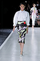 Chiharu Okunugi (New York) walks the runway wearing Prabal Gurung Spring 2014 during Mercedes-Benz Fashion Week in New York on September 5, 2013