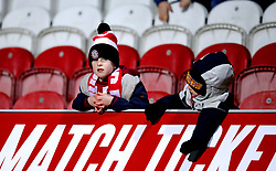 Young Brentford fans in the stands during the FA Cup fourth round replay match at Griffin Park, London.