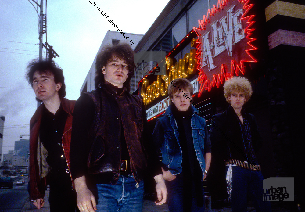 Photo of U2 Bono, Larry Mullen, Adam Clayton, The Edge at gas station in Atlanta - USA Tour 1981