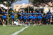 FGR players warming up during the Forest Green Rovers Training session at Browns Sport and Leisure Club, Vilamoura, Portugal on 24 July 2017. Photo by Shane Healey.