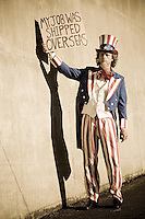 "Uncle Sam character holding a sign reading ""my job was shipped overseas""."