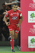 Will Genia leads the Reds onto Suncorp Stadium in front of a record crowd of 30,259 rugby fans during action from Round 11 of the Super 14 Rugby Union match between the Queensland Reds and the South African Stormers played at Suncorp Stadium on Friday 23 April 2010 ~ ©Image Aura Images.com.au ~ Conditions of Use: This image is intended for Editorial use as news and commentry in print, electronic and online media ~ For any alternative use please contact AURA Images.com.au