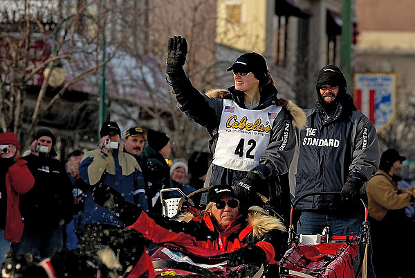 04 March 2006: Anchorage, Alaska - Rachel Scdoris waves to the fans at the start of the Ceremonial Start in downtown Anchorage of the 2006 Iditarod Sled Dog Race.