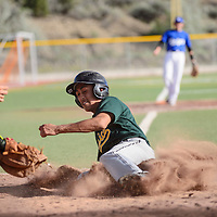 060414  Adron Gardner/Independent<br /> <br /> Athletic  Dillion Marrinez (2) slides home to score on the Dodgers at Ford Canyon Park in Gallup Wednesday.