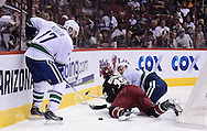 Nov 5, 2013; Glendale, AZ, USA; Vancouver Canucks forward Ryan Kesler (17) gets the puck as defensemen Alexander Edler (23) and Phoenix Coyotes forward Paul Bissonnette (12) lay on the ice in the second period at Jobing.com Arena. Mandatory Credit: Jennifer Stewart-USA TODAY Sports