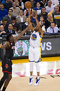 Golden State Warriors forward Andre Iguodala (9) shoots a three pointer against the Houston Rockets at Oracle Arena in Oakland, Calif., on March 31, 2017. (Stan Olszewski/Special to S.F. Examiner)