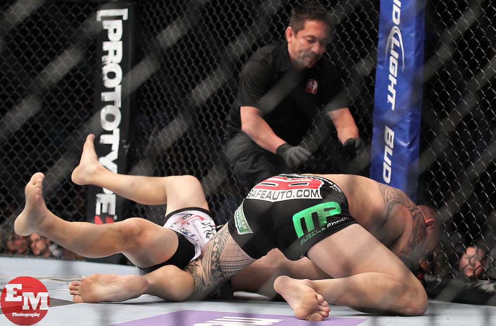 Atlanta, GA - April 21, 2012: Travis Browne (black trunks) and Chad Griggs (white trunks) during UFC 145 at the Phillips Arena in Atlanta, Georgia.