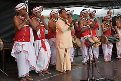 Members of the Ravibandhu Vidyapathy Ensemble taking a bow after a performance at the WOMAD (World of Music; Arts and Dance) Festival in reading; 2005,