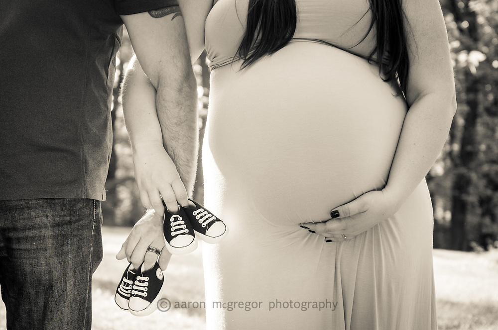 Maternity detail with baby shoes