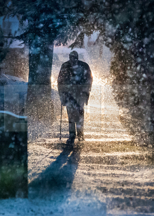 © Licensed to London News Pictures. 10/12/2017. Reading, UK. A parishioner arrives for church near Reading, Berkshire, as parts of the south east of England are blanketed with snow for the first time this winter. Photo credit: Peter Macdiarmid/LNP