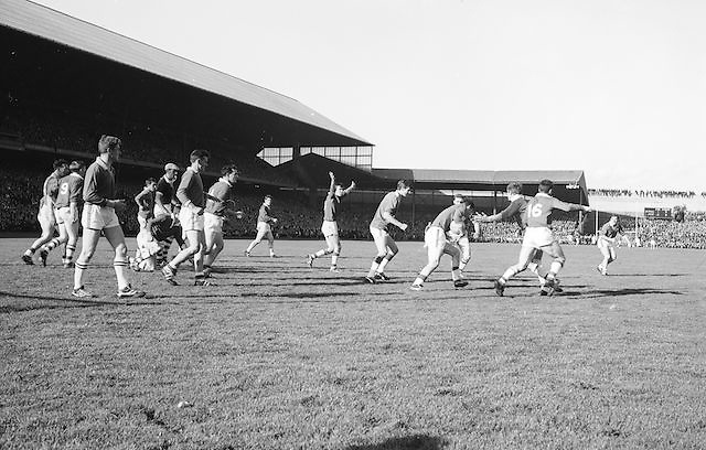 Meath player attempts to run through Cork players during the All Ireland Senior Gaelic Football Final Cork v. Meath in Croke Park on the 24th September 1967.