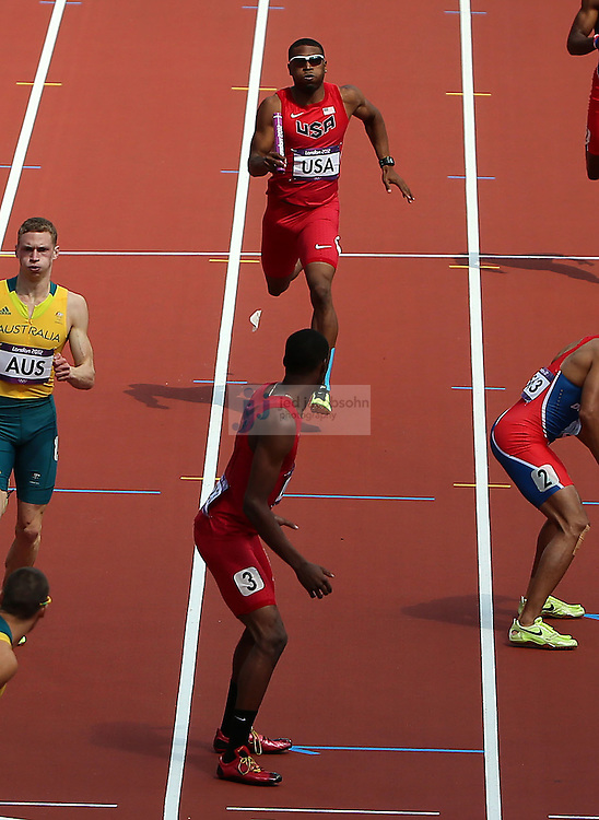 Manteo Mitchell of the USA, rear, runs before passing the baton to teammate Joshua Mance  during the 4X400 during track and field at the Olympic Stadium during day 13 of the London Olympic Games in London, England, United Kingdom on August 9, 2012..(Jed Jacobsohn/for The New York Times)..